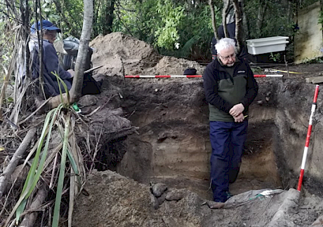 Brooke Tucker and Professor Atholl Anderson examine site stratigraphy during an excavation to salvage eroding archaeological material on Whenua Hou/Codfish Island. Photo: Johannes Fischer